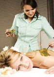 Stock photo attractive lady getting spa treatment in salon, massage doctor smiling care pretty Stock Photography