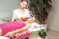 Stock photo attractive lady getting spa treatment in salon, massage doctor smiling care pretty Stock Image
