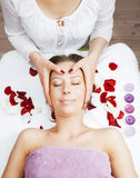 Stock photo attractive lady getting spa treatment in salon, massage doctor smiling care pretty Royalty Free Stock Photography