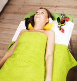 Stock photo attractive lady getting spa treatment in salon, massage doctor smiling Stock Image