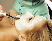 Stock photo attractive lady getting spa treatment in salon, massage doctor smiling Royalty Free Stock Photography