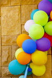 Stock Photo:Balloons of many colours on brick wall Royalty Free Stock Images