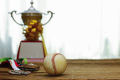 Stock Photo - Baseball with gold Trophy Cup Royalty Free Stock Photos