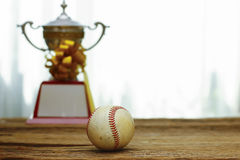 Stock Photo - Baseball with gold Trophy Cup Royalty Free Stock Photography