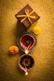 Stock photo of beautiful diwali diya with gift box royalty free stock photo