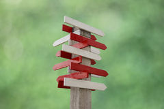 Stock Photo:blank wooden signpost with many arrows Royalty Free Stock Images