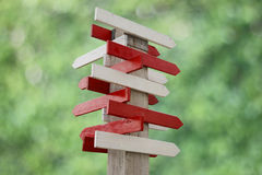 Stock Photo:blank wooden signpost with many arrows Royalty Free Stock Photos