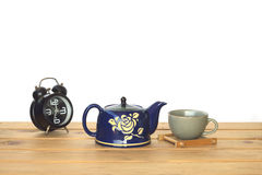 Stock Photo:Blue tea pot on wooden table and white wall with vi Royalty Free Stock Photo