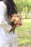 Stock Photo:Bride holding her bouquet behind her back Stock Image
