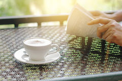 Stock photo :Cappuccino coffee cup on a table with background o Stock Photos
