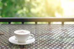 Stock photo :Cappuccino coffee on vintage table in nature and s Royalty Free Stock Photography