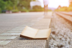 Stock Photo:closeup of an open book on the railroad tracks, wit Stock Photos