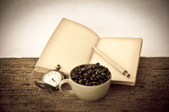 Stock Photo:Coffee beans with old vintage book Stock Photos