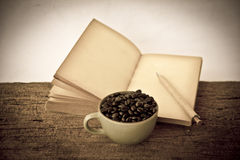 Stock Photo:Coffee beans with old vintage book Royalty Free Stock Images