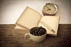 Stock Photo:Coffee beans with old vintage book Royalty Free Stock Photos