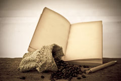 Stock Photo:Coffee beans with old vintage book Stock Image