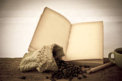 Stock Photo:Coffee beans with old vintage book Stock Images