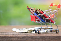 Stock Photo - color pencils in shopping cart. Stock Images