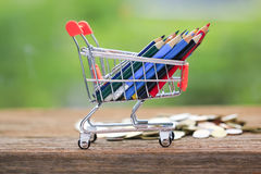 Stock Photo - color pencils in shopping cart. Royalty Free Stock Images