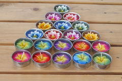 Stock Photo:Colorful candles on wooden tablt with white backgro Stock Photo