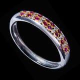 Stock photo: Colorful Gems White Gold Bracelet. A macro shot of a colorful gems white gold bracelet - isolated on a black background Stock Photos