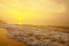 Stock Photo:Colorful sunset at the sand tropical beach Royalty Free Stock Photo