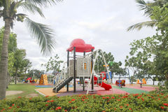 Stock Photo:Colourful playground for children in public park Su Stock Images