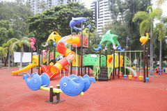 Stock Photo:Colourful playground for children in public park Su Stock Photos