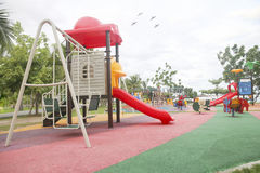 Stock Photo:Colourful playground for children in public park Su Royalty Free Stock Photo