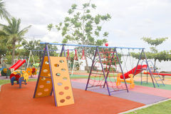 Stock Photo:Colourful playground for children in public park Su Royalty Free Stock Photos