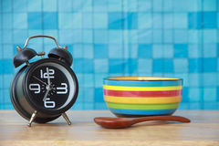 Stock Photo: Concept alarm clock with Colorful soup cups on woo Stock Photos