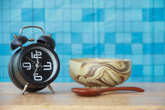 Stock Photo: Concept alarm clock with Colorful soup cups on woo Stock Images