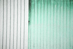 Stock Photo of a Corrugated Metal green and White Background Royalty Free Stock Images