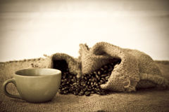 Stock Photo: Cup of coffee with coffee beans Royalty Free Stock Image