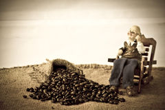 Stock Photo: Cup of coffee with coffee beans Stock Photos
