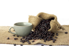 Stock Photo:Cup full of coffee beans on the cloth sack Stock Images
