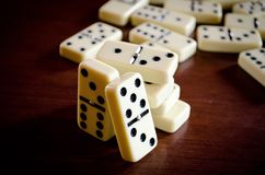 Domino game on the wooden table. Stock photo of the domino on the wooden table stock photography