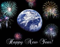Stock photo earth symbol of the new year on our planet happy new year and merry christmas elements of this stock image