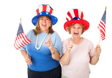 Stock Photo of Enthusiastic American Voters. Enthusiastic American Tea Party voters in patriotic hats and holding flags.  Isolated on white Royalty Free Stock Photos