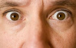 Stock Photo of the Eyes of a Surprised Man Royalty Free Stock Photography