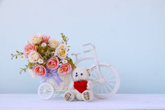 Stock Photo:Fake plastic flower in vase on bicycle Royalty Free Stock Image