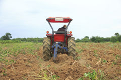 Stock Photo: Farmer was drove tractor plowing the soil to picup Stock Photos