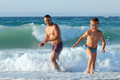 Father and son play in water Royalty Free Stock Image