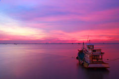 Stock Photo - Fishing boats and the sea in the evening and sunse Royalty Free Stock Images