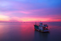 Stock Photo - Fishing boats and the sea in the evening and sunse Stock Photo