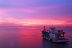 Stock Photo - Fishing boats and the sea in the evening and sunse Stock Photography