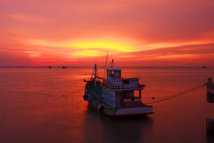 Stock Photo - Fishing boats and the sea in the evening and sunse Royalty Free Stock Photos