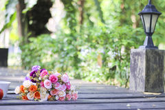 Stock Photo:Flowers bouquet, books and cup on wooden table in a Stock Photo