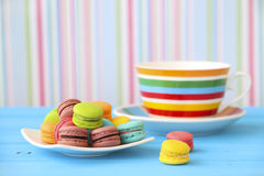 Stock Photo:French macarons in cup on white wooden background.T Stock Image