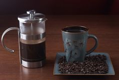 Stock photo of a French press and a coffee cup Royalty Free Stock Photos
